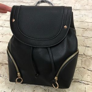 NWT black bag pack gold zipper detail and pockets
